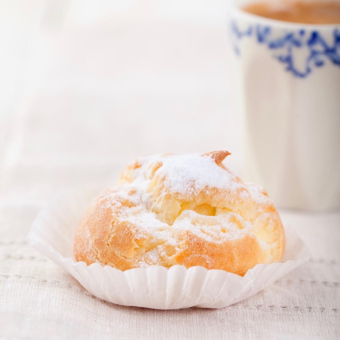 Profiteroles, choux with a custard cream. Dessert
